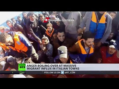 Italian town protests migrant shelter as EU commissioner gets tough