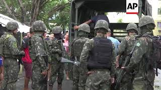 Rio police and military arrest dozens in pre-Carnival raids