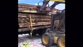 Unloading some Reclaimed Oak Barn Wood Bundles