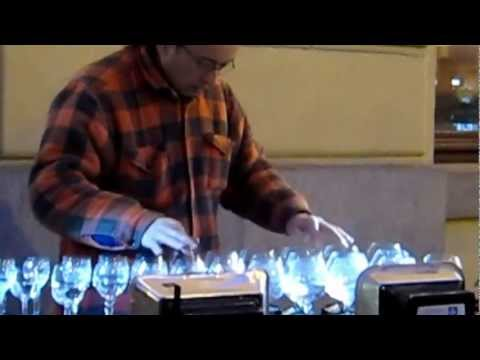 Amazing street musician playing crystal glasses in Prague