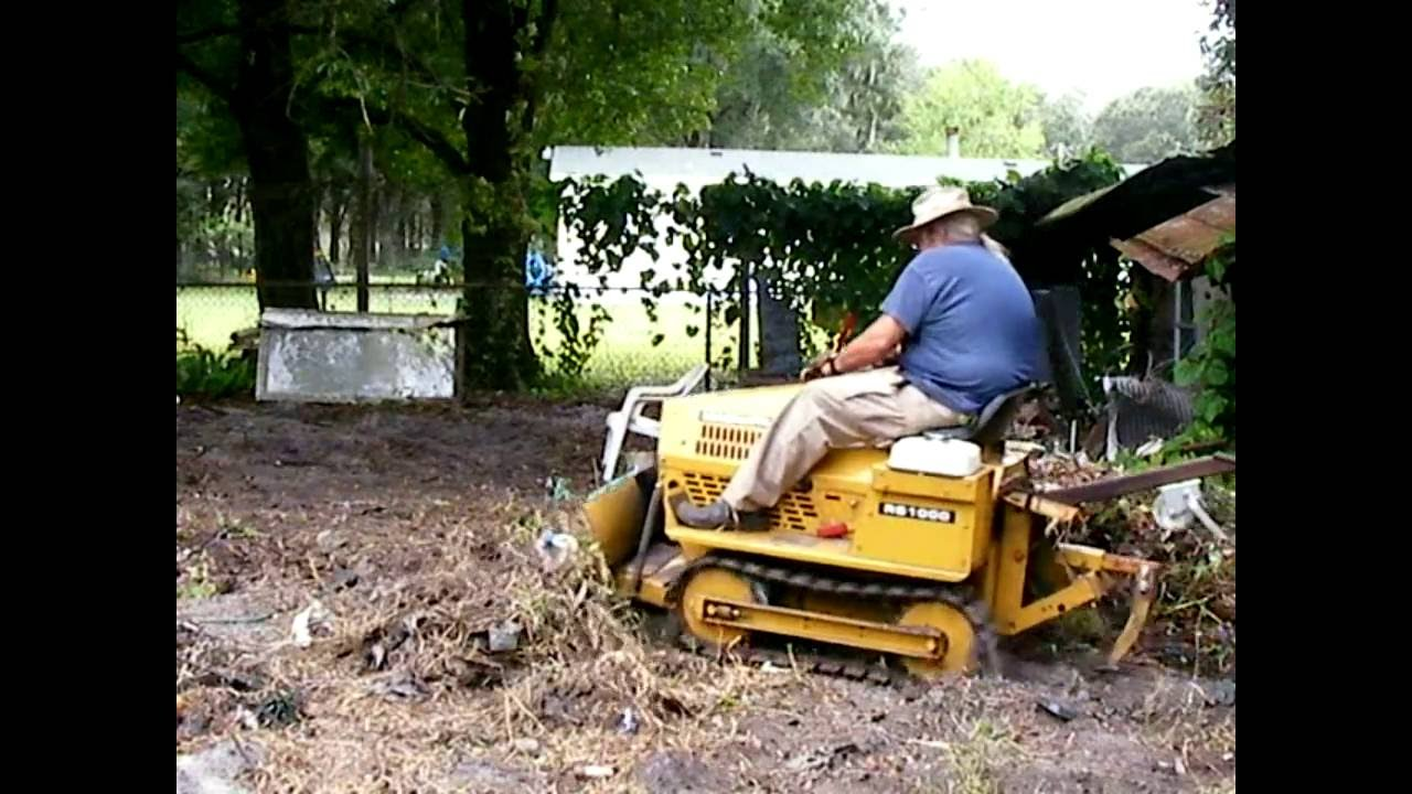 Struck Magnatrac RS1000 bulldozing trash pile