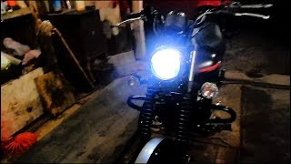 Led H4 bulb in the headlight on the bike Bajaj Avenger 220 Street