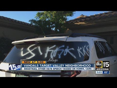 Homes tagged with swastikas