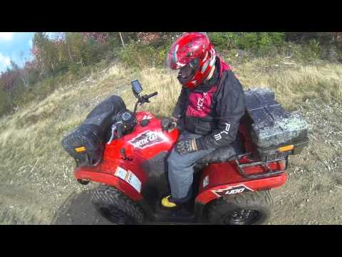 2015 Kingquad on Myra Road trails in Porters Lake Nova Scotia..... things are getting sketchy lol