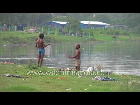 People bathe in the Yamuna River in Delhi - another cause of pollution