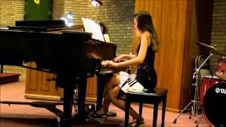 Tara playing piano in church Aug 14