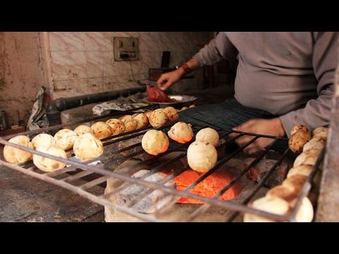 Delicious Indian Street Food Round Roti (Baati Chokha) on a Backlane in Varanasi, India