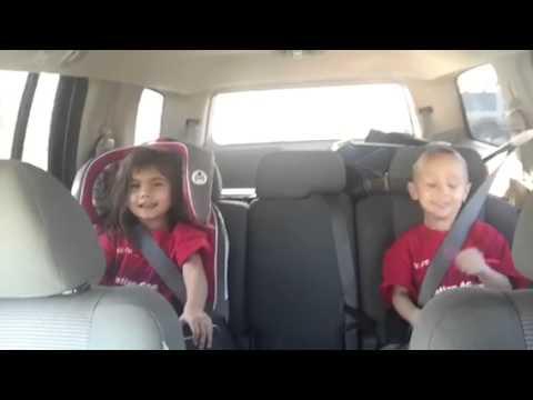Midgets singing praises in car seats
