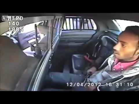 Criminal Pulls Gun In Back Seat Of Police Car