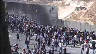 Palestinians trying to tear down the Apartheid Wall near Jerusalem