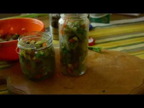 Закусочный салат на зиму с кислыми огурцами, горошком и сухими грибами.