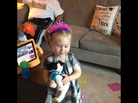 Kennedy shoes her new stuffed pug to the real pugs