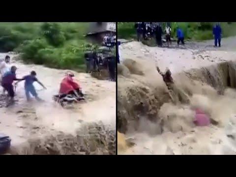 Man on Motorcycle Swept Away by Flood Waters in Nepal
