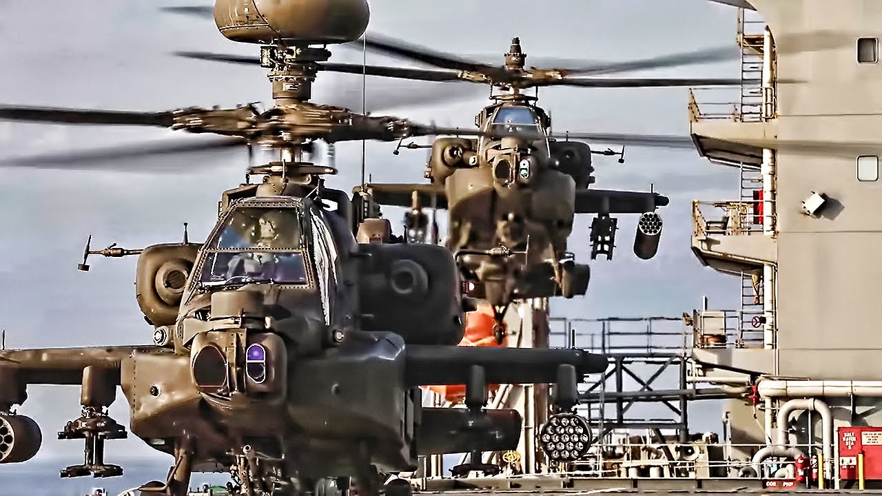Apache Helicopters Deck Landing Quals On USN Vessel