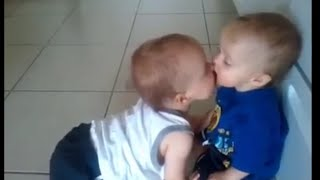 baby kissing each others compliance