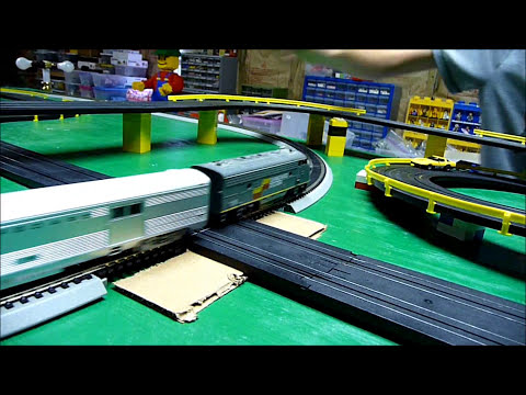 Model Railroad Toy Train Track Plans -HO Slot Cars versus Passenger Train on our layout – Crashes at Road & Rail crossing