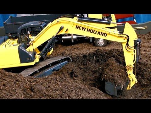 new holland e265 c bagger excavator at work doovi. Black Bedroom Furniture Sets. Home Design Ideas