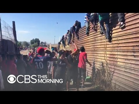 U.S. border crossing reopens after tense clashes with migrants