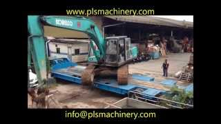 SK07N2 SOLD BY PLS MACHINERY PTE LTD BEING LOADED ON TO TRAILER AND SENT INTO MALAYSIA