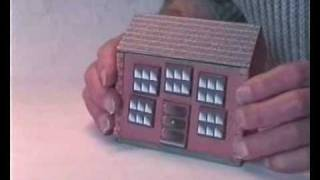 A simple sliding panel puzzle box that could be used as a money-box.