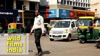 Jay Walker And Busy Traffic Near Siddi Saiyyed Masjid,  Ahmedabad