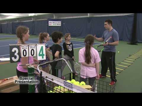 Three Young Fredericton Tennis Players Get Ready for a National Tennis Match.