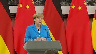 ميركل تؤكد من الصين دعمها للاتفاق النووي الإيراني