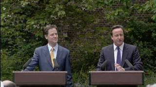 Cameron and Clegg share a joke