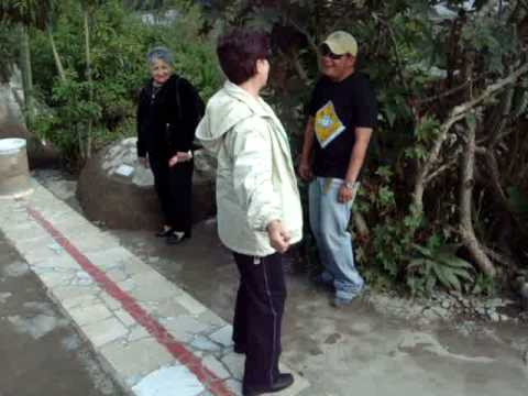 People trying to balance while walking on the Equator