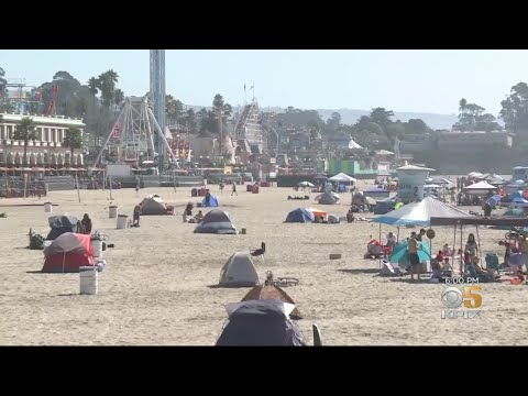 Tourists And Growing Homeless Encampment Share Santa Cruz Sands