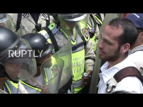 Venezuela: Protesters clash with riot police at anti-Maduro protest in Caracas