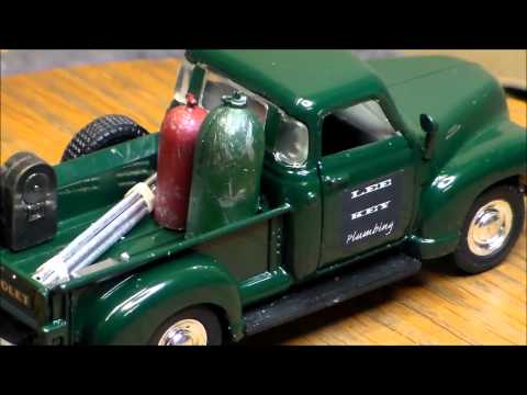 Dark green pickup truck