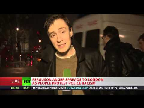 London to Ferguson Crowd protesting police racism tears down Parliament Square barriers