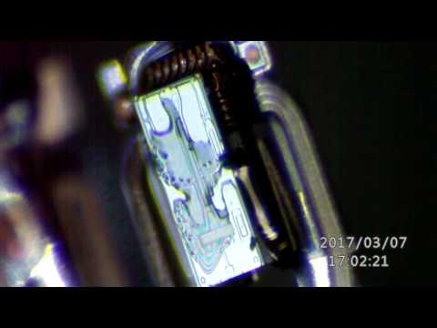 Cleaning Contaminated Hard Drive Heads Under Microscope for Data Recovery