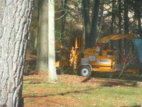 Sprague public works crew uses chipper on property owned by town selectman