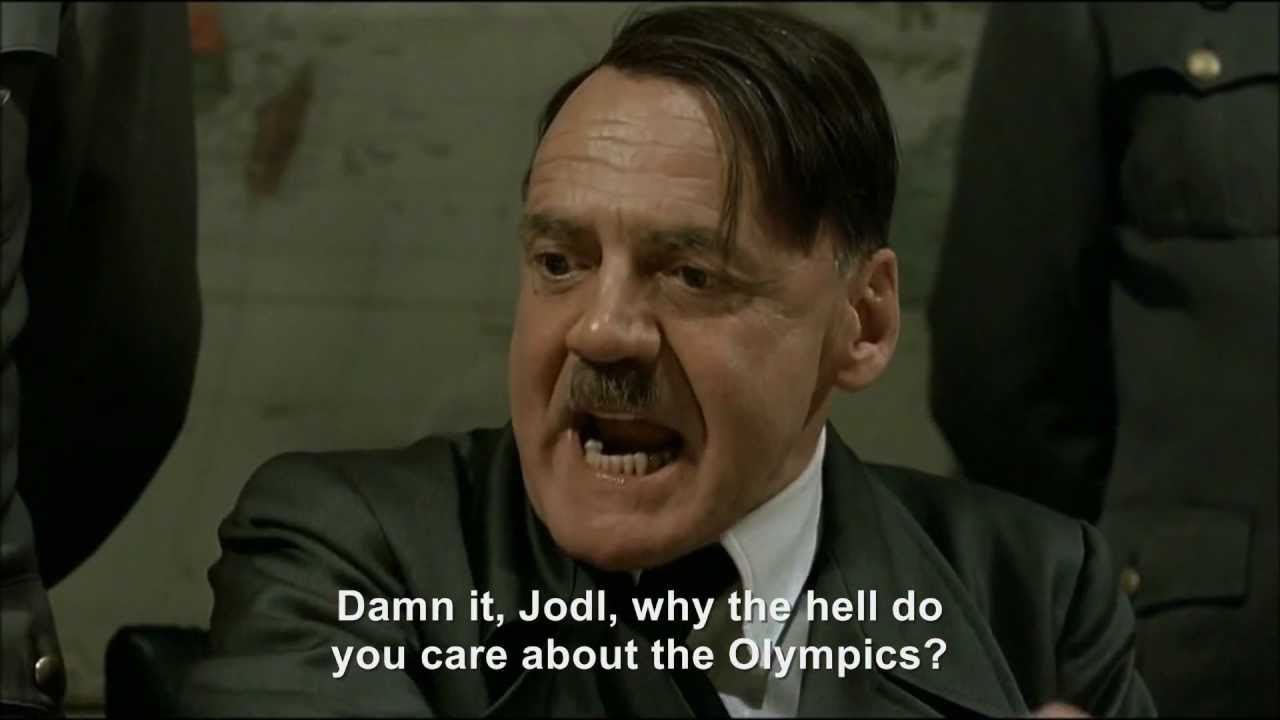 Hitler tries to grab the Olympic torch‎
