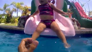 Travelle's first pool slide attemp
