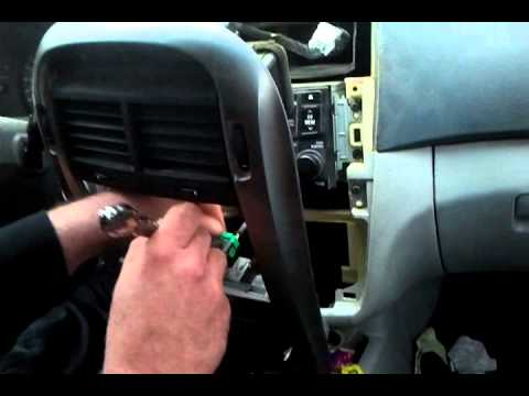 Removing factory car stereo 2005 kia spectra - YouTube