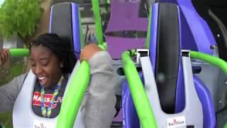 Entertainment reporter Ellanje Ferguson rides the new JOKER coaster at Six Flags New England