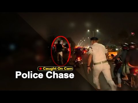 Download Policeman Chases & Nabs Youth Creating Ruckus On Busy Bhubaneswar Street | OTV News
