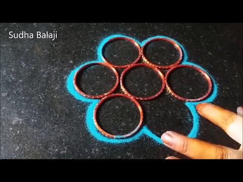 Diwali rangoli designs  with colours   Easy peacock rangoli   Tools - paper cups, ice cream sticks