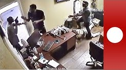 Garage shootout: Shop manager fights back against armed robbers, Florida