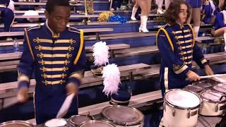The A. I. duPont High School Band during various moments from the 2...