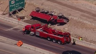 Surveillance video shows dump truck tip over in Zoo Interchange construction zone