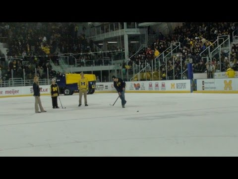GUY HITS SHOT FROM CENTER ICE @ MICHIGAN HOCKEY GAME SCORE-O!!! (GO BLUE!!!)