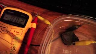 Rock electrode makes other electrodes negative