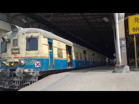 Thane bound retrofitted EMU entering Airoli