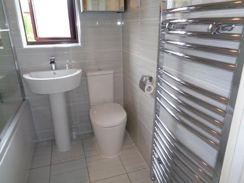 New Fitted Bathroom with grey tiles chrome finishing
