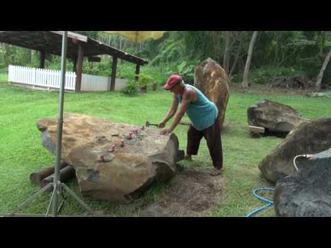 Splitting Rarotongan basalt rock with wedges