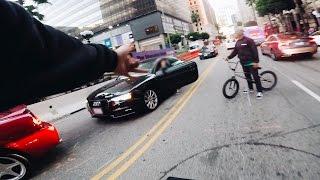 BMX vs CRAZY DRIVER IN TRAFFIC